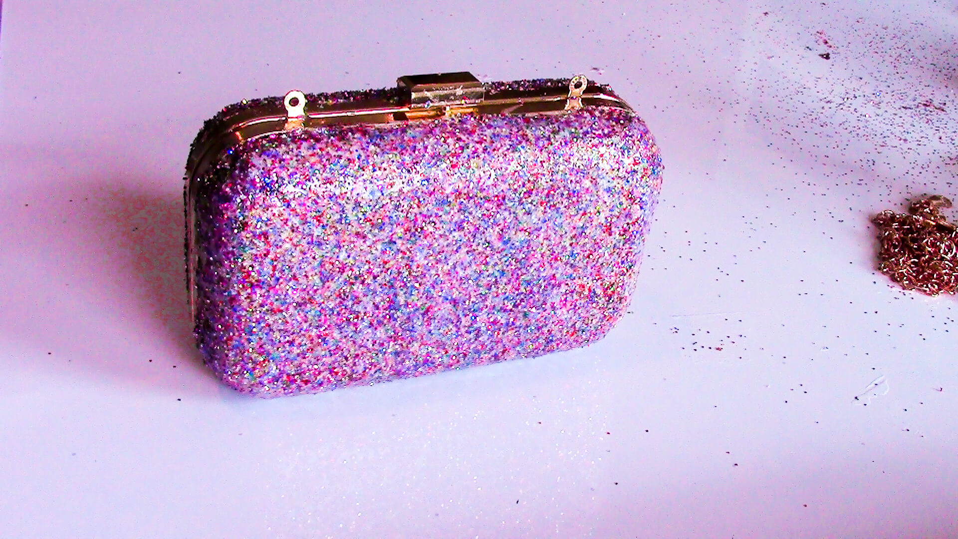 Mod Podge Glitter onto clutch